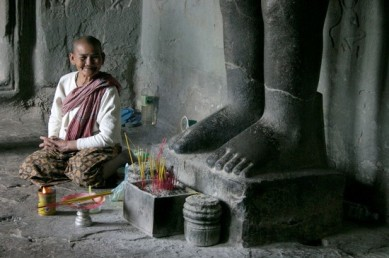 angkor-wat-monk-in-temple-at-bottom-of-feet-of-buddha-james-gritz.jpg